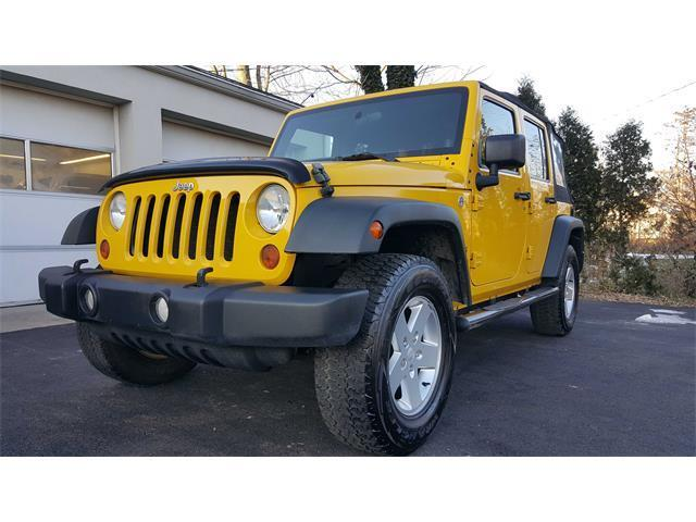 clean and sharp 2011 Jeep Wrangler Unlimited Sport 4×4