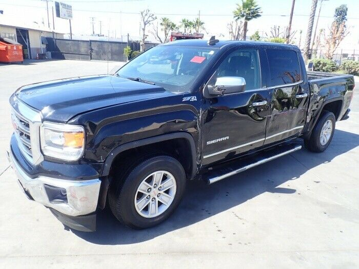 damaged 2015 GMC Sierra 1500 SLT 4×4